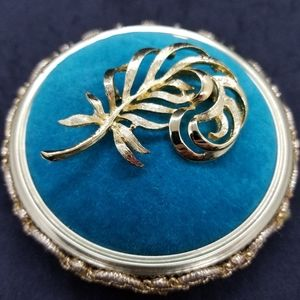 Napier gold-tone flourished feather pin/brooch